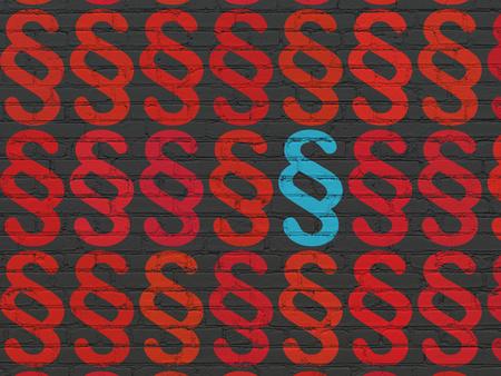 Concepto de ley: filas de iconos de párrafo rojo pintado alrededor de icono de párrafo azul sobre fondo de pared de ladrillo negro