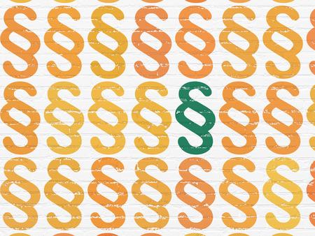Concepto de ley: filas de iconos de párrafo naranja pintados alrededor de icono de párrafo verde sobre fondo de pared de ladrillo blanco