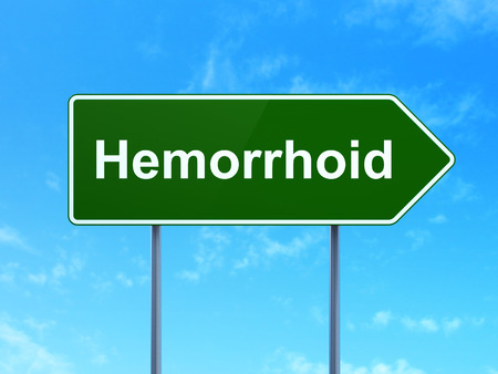 hemorrhoid: Healthcare concept: Hemorrhoid on green road highway sign, clear blue sky background, 3D rendering