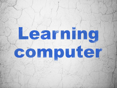 studying computer: Studying concept: Blue Learning Computer on textured concrete wall background Stock Photo