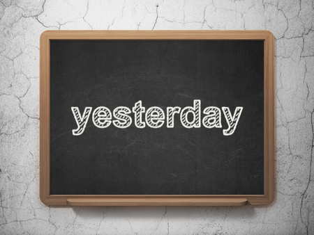 Time concept: text Yesterday on Black chalkboard on grunge wall background, 3D rendering Stock Photo