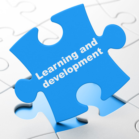 brainteaser: Education concept: Learning And Development on Blue puzzle pieces background, 3D rendering