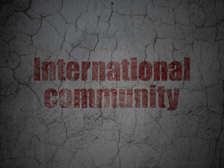 Politics concept: Red International Community on grunge textured concrete wall background