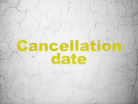Time concept: Yellow Cancellation Date on textured concrete wall background