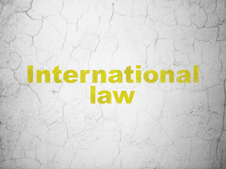 Politics concept: Yellow International Law on textured concrete wall background Stock Photo