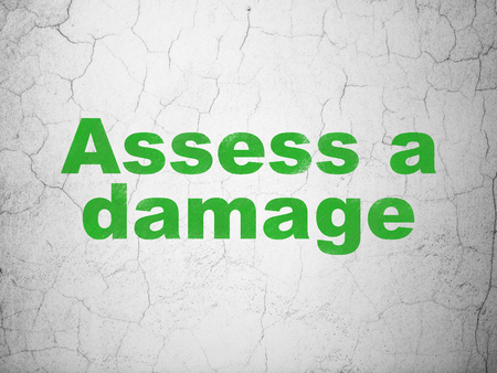 Insurance concept: Green Assess A Damage on textured concrete wall background Stock Photo