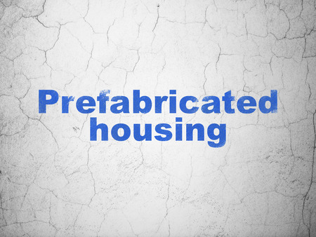 abandoned house: Building construction concept: Blue Prefabricated Housing on textured concrete wall background