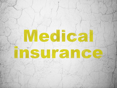 Insurance concept: Yellow Medical Insurance on textured concrete wall background
