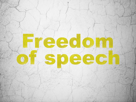 Politics concept: Yellow Freedom Of Speech on textured concrete wall background Stock Photo