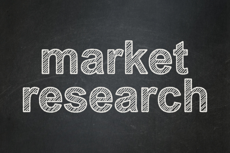 Advertising concept: text Market Research on Black chalkboard background