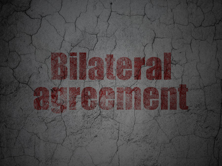 Insurance concept: Red Bilateral Agreement on grunge textured concrete wall background Stock Photo