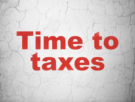 Timeline concept: Red Time To Taxes on textured concrete wall background