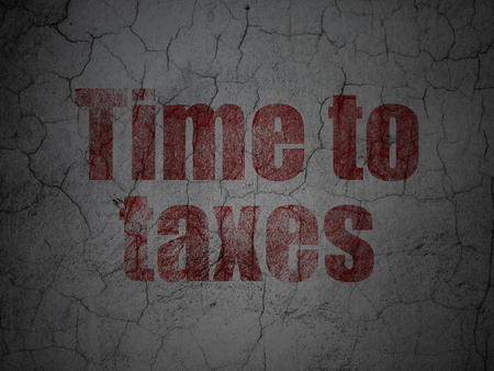 Time concept: Red Time To Taxes on grunge textured concrete wall background Stock Photo