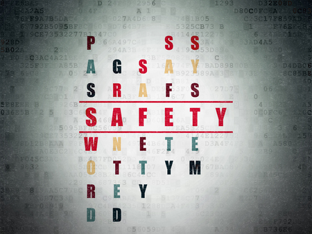 Protection concept: Painted red word Safety in solving Crossword Puzzle on Digital Data Paper background Stock Photo
