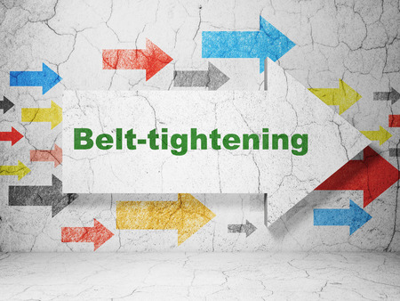Business concept:  arrow with Belt-tightening on grunge textured concrete wall background, 3D rendering Stock Photo