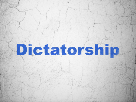 Politics concept: Blue Dictatorship on textured concrete wall background Stock Photo