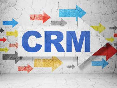 Business concept:  arrow with CRM on grunge textured concrete wall background, 3D rendering