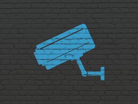 Protection concept: Painted blue Cctv Camera icon on Black Brick wall background