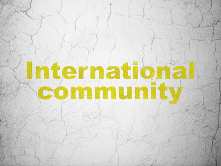 Politics concept: Yellow International Community on textured concrete wall background Stock Photo