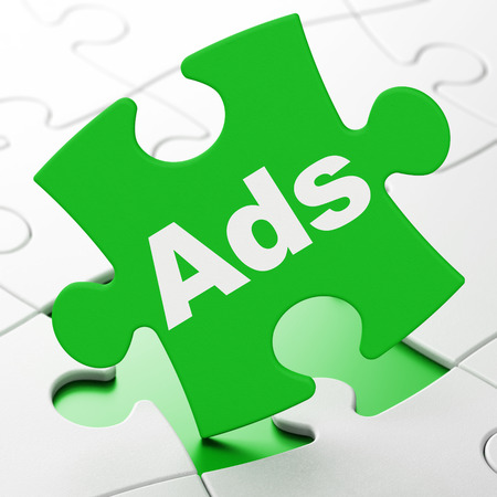 Marketing concept: Ads on Green puzzle pieces background, 3D rendering