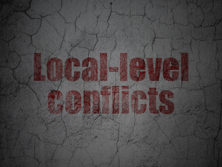 Political concept: Red Local-level Conflicts on grunge textured concrete wall background Stock Photo