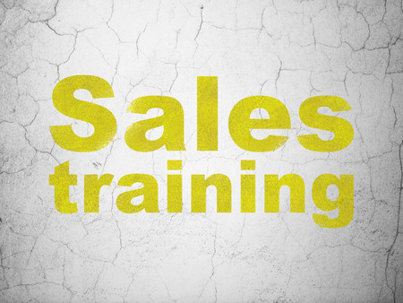 Advertising concept: Yellow Sales Training on textured concrete wall background Stock Photo