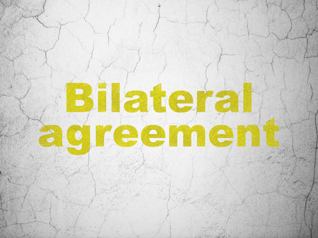 Insurance concept: Yellow Bilateral Agreement on textured concrete wall background Stock Photo