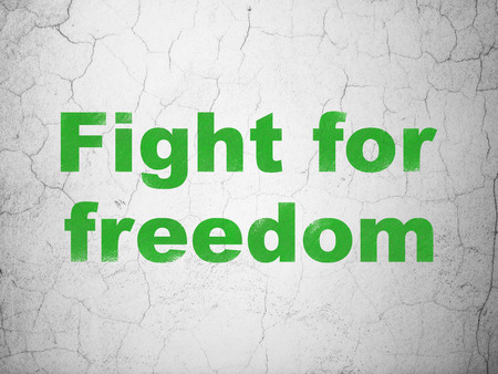 Political concept: Green Fight For Freedom on textured concrete wall background