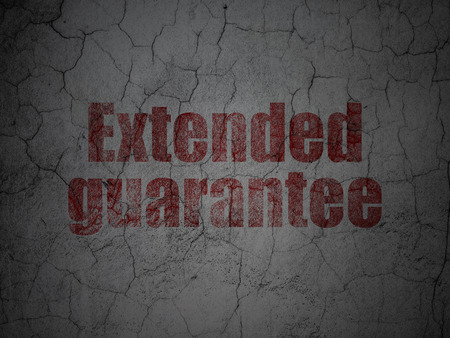 Insurance concept: Red Extended Guarantee on grunge textured concrete wall background