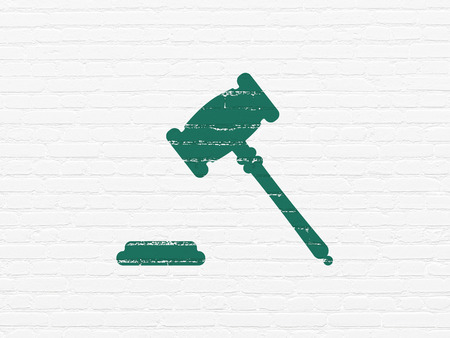 building regulations: Law concept: Painted green Gavel icon on White Brick wall background