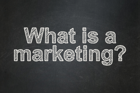 Marketing concept: text What is a Marketing? on Black chalkboard background Banco de Imagens