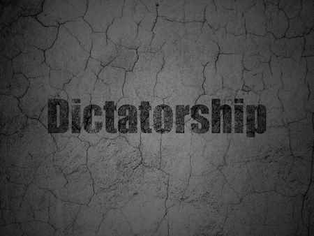Political concept: Black Dictatorship on grunge textured concrete wall background Stock Photo