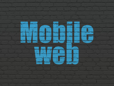 seo: Web design concept: Painted blue text Mobile Web on Black Brick wall background