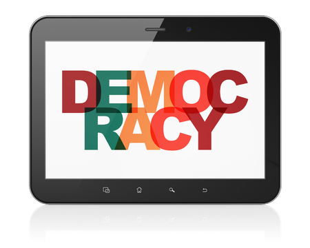 politic: Political concept: Tablet Computer with Painted multicolor text Democracy on display, 3D rendering Stock Photo
