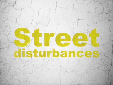 politic: Political concept: Yellow Street Disturbances on textured concrete wall background