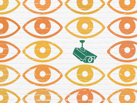 Protection concept: rows of Painted orange eye icons around green cctv camera icon on White Brick wall background