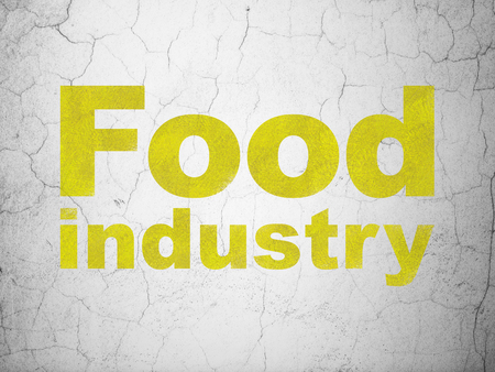 Manufacuring concept: Yellow Food Industry on textured concrete wall background