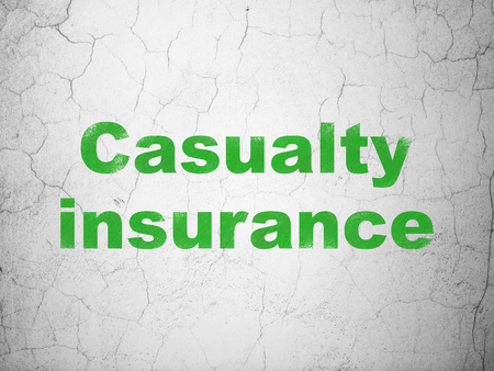 Insurance concept: Green Casualty Insurance on textured concrete wall background Stock Photo