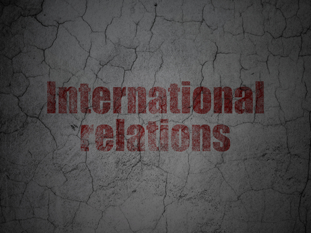 Politics concept: Red International Relations on grunge textured concrete wall background Stock Photo