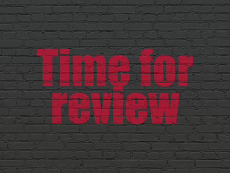 Time concept: Painted red text Time for Review on Black Brick wall background Stock Photo - 88159479