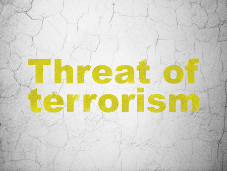 Politics concept: Yellow Threat Of Terrorism on textured concrete wall background Stock Photo