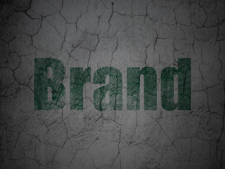 Advertising concept: Green Brand on grunge textured concrete wall background Banco de Imagens