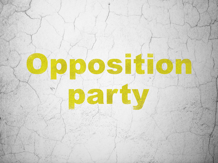 Politics concept: Yellow Opposition Party on textured concrete wall background