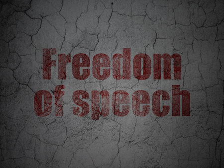 Politics concept: Red Freedom Of Speech on grunge textured concrete wall background