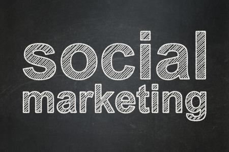 Marketing concept: text Social Marketing on Black chalkboard background Banco de Imagens
