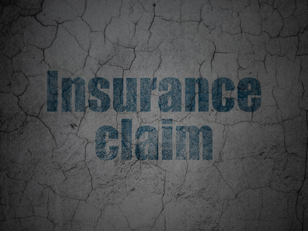 Insurance concept: Blue Insurance Claim on grunge textured concrete wall background