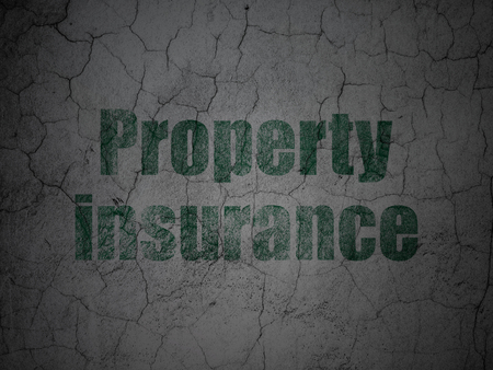 Insurance concept: Green Property Insurance on grunge textured concrete wall background Stock Photo - 88780908