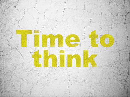Time concept: Yellow Time To Think on textured concrete wall background