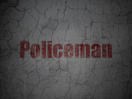Law concept: Red Policeman on grunge textured concrete wall background Stock Photo