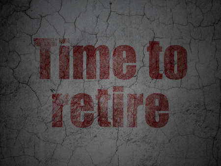 Time concept: Red Time To Retire on grunge textured concrete wall background Stock Photo